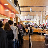 People buying food in the Curve Restaurant at Queen Mary University of London